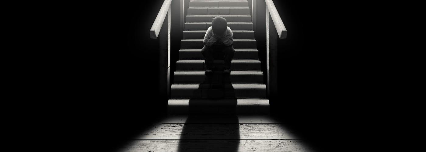 sad child on stairs